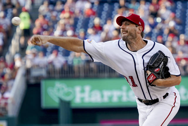 Washington Nationals starting pitcher Max Scherzer (31) pitches in the first inning of a baseball game against the Boston Red Sox at Nationals Park, Monday, July 2, 2018, in Washington. (AP Photo/Andrew Harnik)