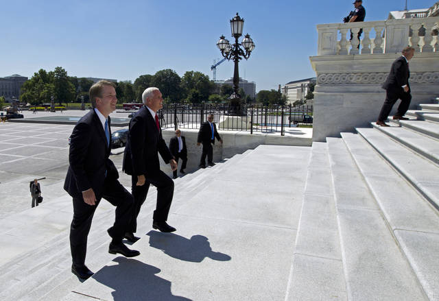 Vice President Mike Pence, right, accompanied by Supreme Court nominee Judge Brett Kavanaugh, arrives at the U.S. Capitol in Washington on Tuesday, July 10, 2018. (AP Photo/Jose Luis Magana)