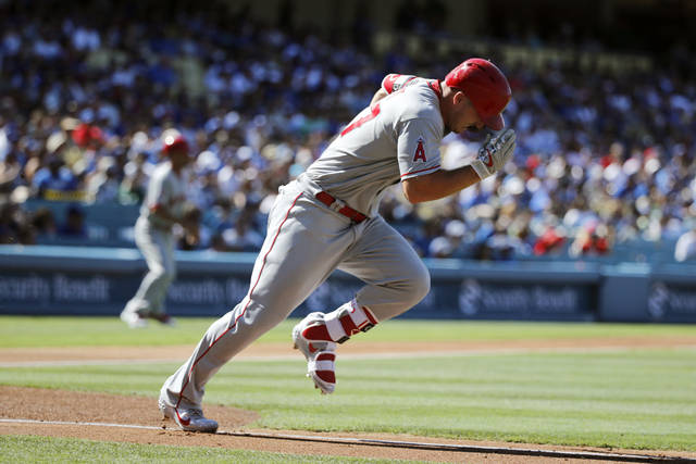 Los Angeles Angels' Mike Trout runs to first base after hitting a single during the first inning of the team's baseball game against the Los Angeles Dodgers, Saturday, July 14, 2018, in Los Angeles. (AP Photo/Jae C. Hong)