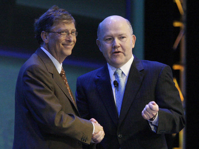 FILE - In this June 29, 2010 file photo, Microsoft founder Bill Gates, left, shakes hands with Nelson Smith, who at the time was President and CEO of the National Alliance for Public Charter Schools, during the National Charter Schools Conference in Chicago. All told, the Bill and Melinda Gates Foundation has given about $25 million to the Washington State Charter Schools Association, and since 2006, philanthropists and their private foundations and charities have given almost half a billion dollars to similar groups, according to an Associated Press analysis of tax filings and Foundation Center data. (AP Photo/Kiichiro Sato, file)