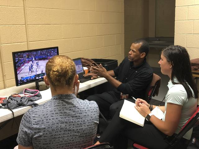 NBA referee Eric Lewis breaks down a play with referees Ashley Gilpin, left, and Natalie Sago, right, after an NBA Summer League game in Las Vegas on Monday, July 9, 2018. Lewis and other established NBA refs are leading classes for summer league officials in Las Vegas as part of an NBA initiative to find future refs for their league. (AP Photo/Tim Reynolds)