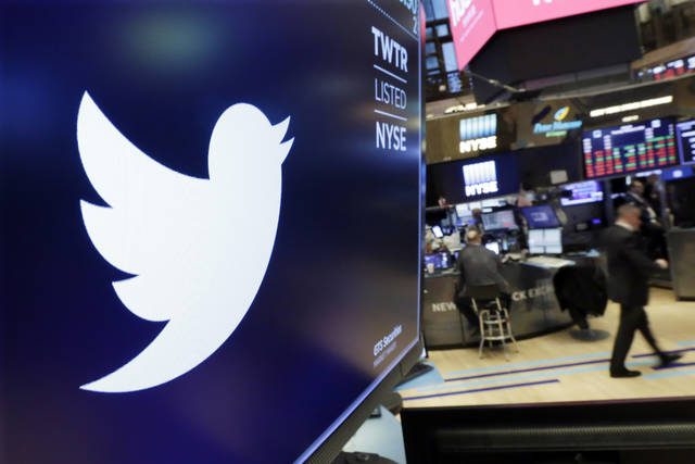FILE - In this Feb. 8, 2018 file photo, the logo for Twitter is displayed above a trading post on the floor of the New York Stock Exchange.  Twitter suspended at least 58 million user accounts in the final three months of 2017, according to data obtained by The Associated Press. The figure highlights the company's newly aggressive stance against malicious or suspicious accounts in the wake of Russian disinformation efforts during the 2016 U.S. presidential campaign.  (AP Photo/Richard Drew, File)