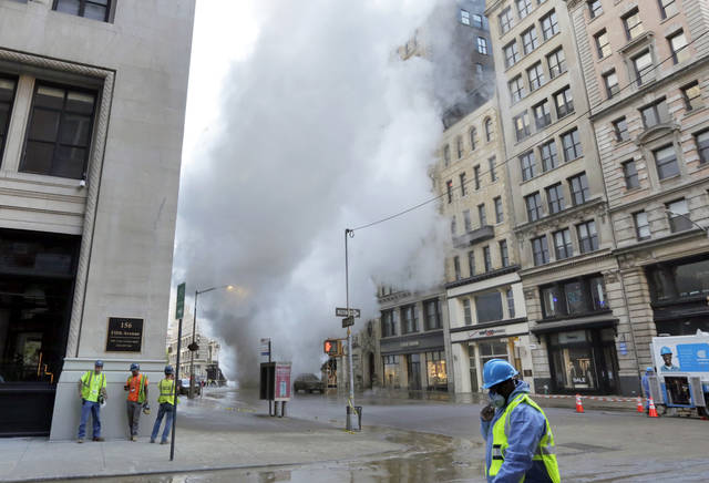 Steam billows on New York's Fifth Avenue, Thursday, July 19, 2018. A steam pipe exploded beneath Fifth Avenue in Manhattan early Thursday, sending chunks of asphalt flying, a geyser of billowing white steam stories into the air and forcing pedestrians to take cover. (AP Photo/Richard Drew)