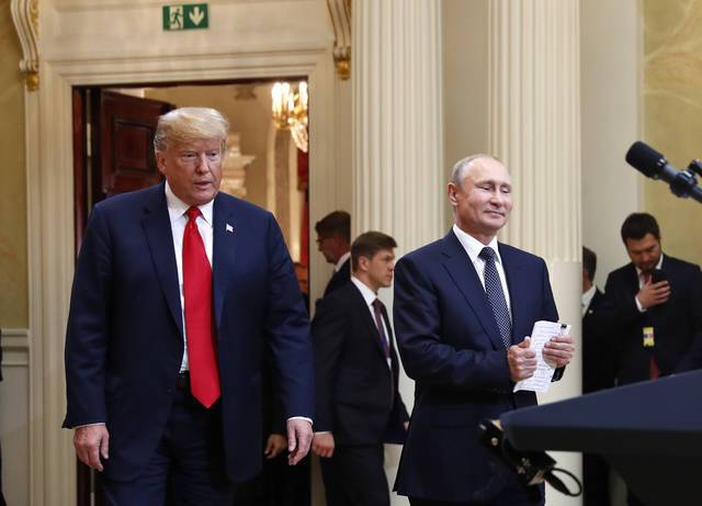 In this July 16, 20198, photo, U.S. President Donald Trump, left, and Russian President Vladimir Putin arrive for a news conference at the Presidential Palace in Helsinki, Finland. Trump has asked national security adviser John Bolton to invite Putin to Washington in the fall. That's the latest update Thursday from White House press secretary Sarah Huckabee Sanders following Trump's meeting with Putin earlier this week in Finland. (AP Photo/Pablo Martinez Monsivais)
