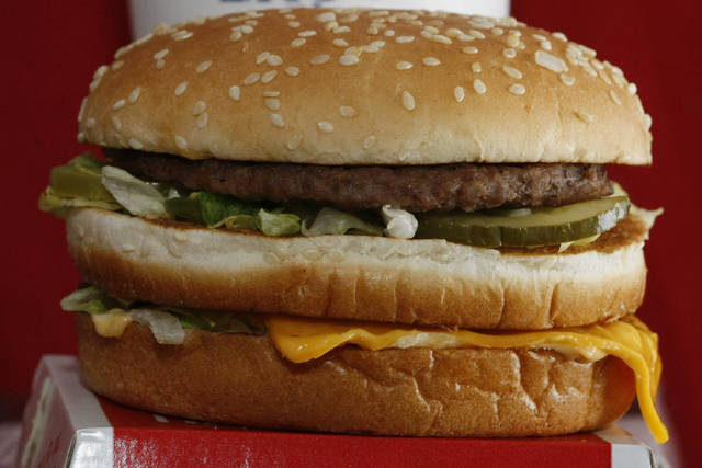 FILE - This Dec. 29, 2009 file photo shows a Big Mac hamburger at a McDonald's restaurant in North Huntingdon, Pa. The fast food restaurant is celebrating the sandwich's 50th anniversary in 2018. (AP Photo/Keith Srakocic)