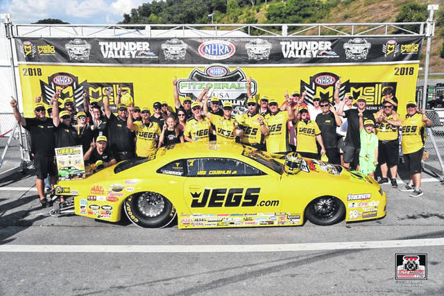 Team Jegs celebrates around Jeg Coughlin Jr.'s winning Pro Stock Camaro.