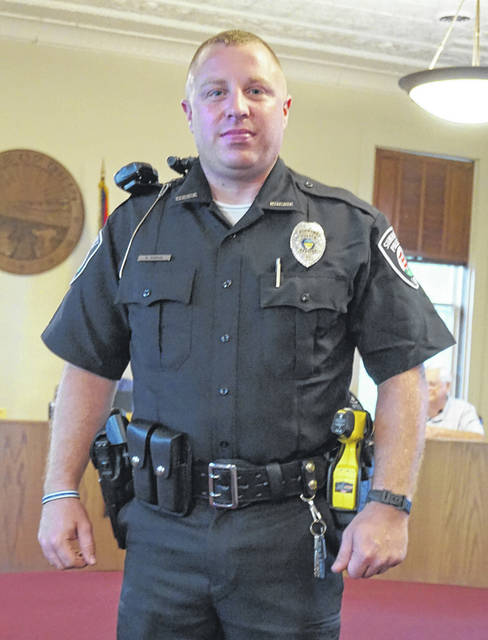 Officer Matthew Bowman models the Sunbury Police Department's new uniform during Wednesday's Village Council meeting.