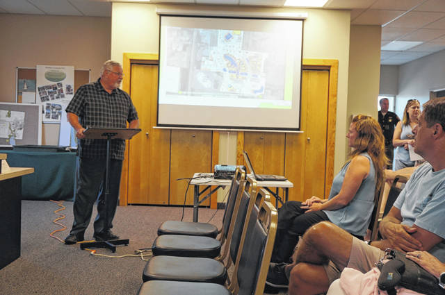 Berkshire Trustee Bill Holtry gives a presentation about the proposed Planet Oasis development at a meeting in the Township Hall on July 9. Despite the empty seats in the front row, the meeting drew dozens of people.