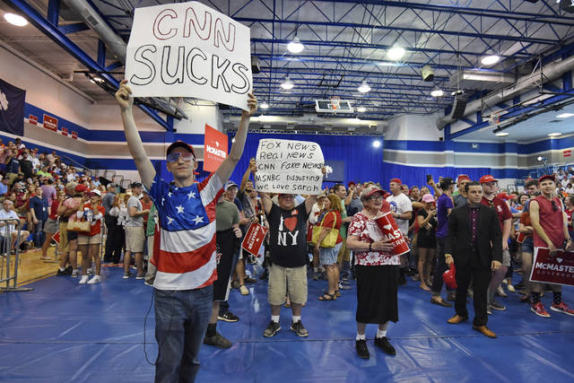 Protesters gather in front of the media before President Trump who is in town to support Gov. Henry McMaster speaks to the crowd at Airport High School Monday, June 25, 2018, in West Columbia, S.C. (AP Photo/Richard Shiro)