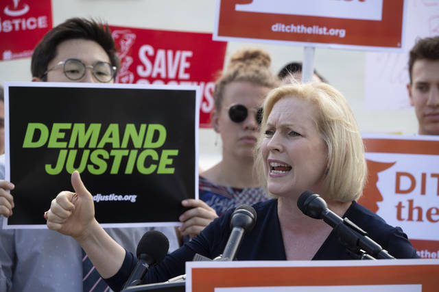 "Sen. Kirsten Gillibrand, D-N.Y., joins activists at the Supreme Court as President Donald Trump prepares to choose a replacement for Justice Anthony Kennedy, in Washington, Thursday, June 28, 2018. Gillibrand says Kennedy's retirement sets up a situation where ""women's lives are at risk.""  (AP Photo/J. Scott Applewhite)"