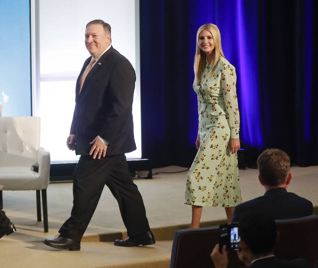 Secretary of State Mike Pompeo, left, walks in with Ivanka Trump, the daughter and assistant to President Donald Trump, during an event to announce the 2018 Trafficking in Persons Report (TIP) ceremony at the US State Department in Washington, Thursday, June 28, 2018. (AP Photo/Pablo Martinez Monsivais)