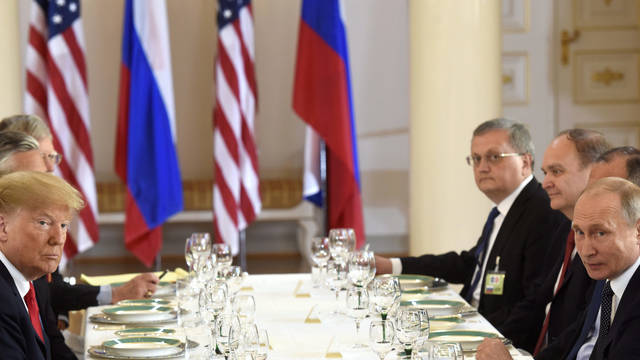 US President of the United States of America Donald Trump, left and Russia's President Vladimir Putin sit opposite each other during their working lunch of the Helsinki Summit with  U.S. and Russian delegations in Helsinki, Finland July 16, 2018. (Heikki Saukkomaa/Lehtikuva via AP)