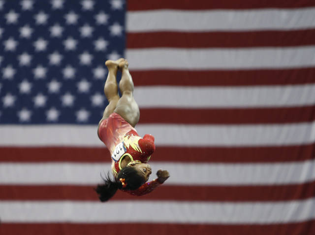 Olympic champion Simone Biles competes on the vault during the U.S. Classic gymnastics competition Saturday, July 28, 2018, in Columbus, Ohio. The U.S. Classic is Biles first competition since the 2016 Games. (AP Photo/Jay LaPrete)