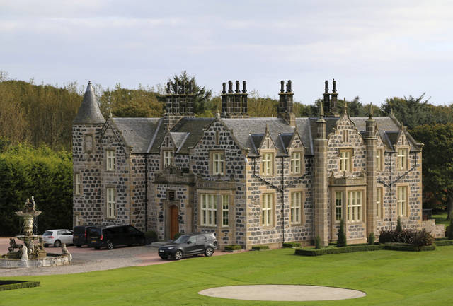 "FILE - This Friday Oct. 6, 2017 file photo shows a view of MacLeod House, a sixteen room boutique hotel, at the Trump International golf course in Balmedie, Scotland. Documents show that U.S. President Donald Trump's family business has ""destroyed the vast majority'' of an environmentally sensitive patch of sand dunes near its golf course north of Aberdeen in Scotland. Scottish Natural Heritage, which is responsible for the management and monitoring of sites of special scientific interest, has found that construction of the golf course has ""led to direct loss of"" as much as 68 hectares (168 acres) of mobile sand dunes protected under Scottish law. (AP Photo/Renee Graham, file)"