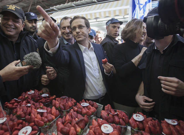 FILE - In this March 12, 2015 file photo, then co-leader of the center-left Zionist Union Isaac Herzog visits a market in Tel Aviv, Israel. On Wednesday, Aug. 1, 2018, three years after he narrowly missed out on becoming prime minister of Israel, Herzog will became the chairman of the Jewish Agency. Herzog told The Associated Press he sees an even higher calling in heading the non-governmental organization devoted to bridging the gap between Israel and the more liberal Jewish Diaspora. (AP Photo/Dan Balilty, File)