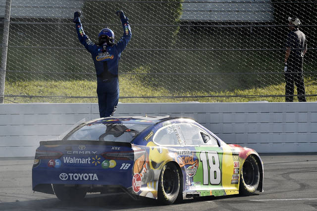 Kyle Busch celebrates after winning a NASCAR Cup Series auto race, Sunday, July 29, 2018, in Long Pond, Pa. (AP Photo/Derik Hamilton)