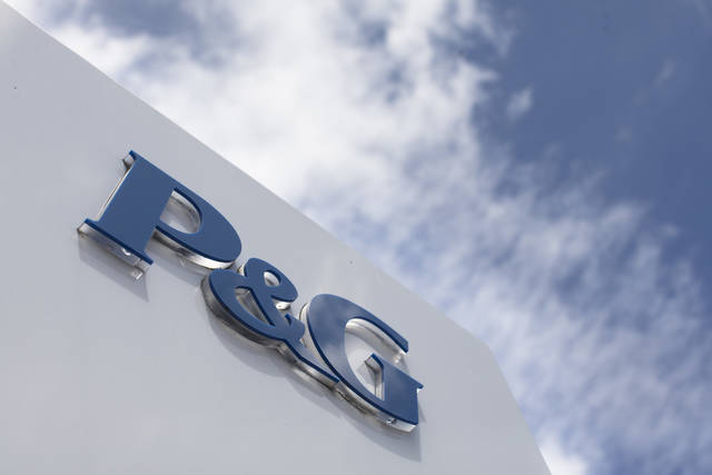 FILE - This July 9, 2015, file photo, shows signage outside Procter & Gamble corporate headquarters in downtown Cincinnati. Procter & Gamble Co. (PG) on Tuesday, July 31, 2018, reported fiscal fourth-quarter net income of $1.89 billion. (AP Photo/John Minchillo, File)