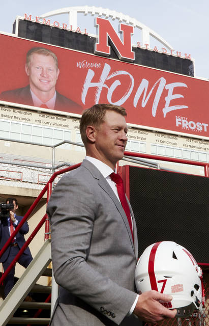 In this Dec. 3, 2017, photo, Nebraska NCAA college football head coach Scott Frost poses for a photo at Memorial Stadium in Lincoln, Neb. Frost has said repeatedly that Nebraska made a mistake moving away from the methods former coach Tom Osborne successfully used. Frost's job is to return his team to the place it held in the college football hierarchy two decades ago by returning to the methods Osborne used on and off the field to make the Cornhuskers great. (AP Photo/Nati Harnik)