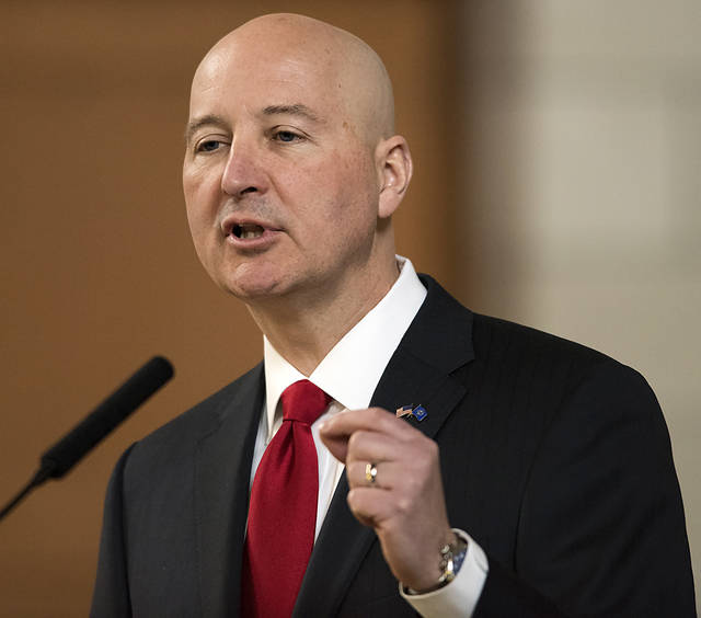 """FILE - In this April 18, 2018, file photo, Nebraska Gov. Pete Ricketts speaks at the legislature, in Lincoln, Neb. Pope Francis' decree that the death penalty is """"inadmissible"""" in all cases could pose a dilemma for Roman Catholic politicians and judges in the United States. Ricketts, a Republican and Catholic who worked to reinstate capital punishment in his state after lawmakers abolished it in 2015, said the pope's decree doesn't change his stance. (Gwyneth Roberts/Lincoln Journal Star via AP, File)"""