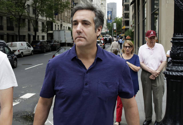 FILE - In a Monday, July 30, 2018 file photo, Michael Cohen, formerly a lawyer for President Trump, leaves his hotel, in New York. Attorney Barbara Jones revealed in a letter filed Thursday, Aug. 9, 2018, in Manhattan federal court that she has completed her review of designations by lawyers for attorney Michael Cohen, Trump and the Trump Organization. After the April 9 raid of Cohen's office and residences, Cohen asked a judge to give him a role in deciding what seized items were privileged and could not be seen by prosecutors. The judge appointed Jones.  (AP Photo/Richard Drew, File)