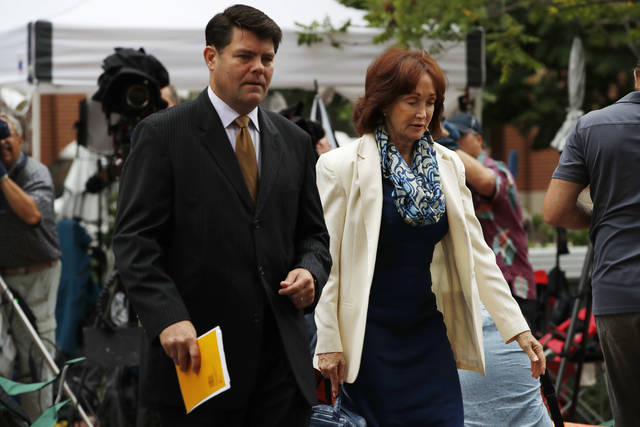 Paul Manafort's wife Kathleen Manafort, right, walks with Manafort spokesman Jason Maloni, to federal court for jury deliberations in the trial of the former Trump campaign chairman, in Alexandria, Va., Tuesday, Aug. 21, 2018. (AP Photo/Jacquelyn Martin)