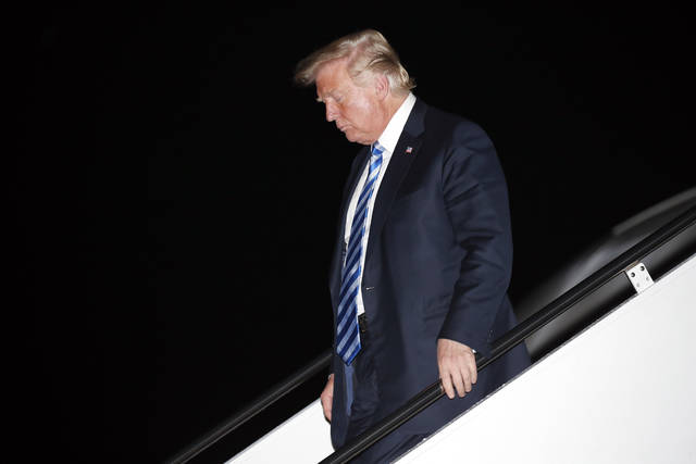 President Donald Trump steps off Air Force One as he arrives Tuesday, Aug. 21, 2018, at Andrews Air Force Base, Md. (AP Photo/Alex Brandon)