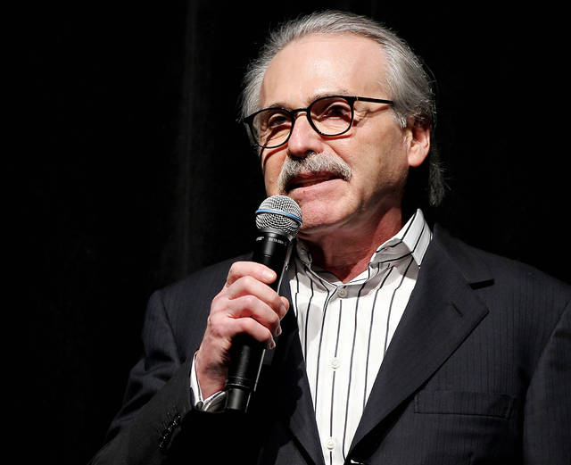 In this Jan. 31, 2014 photo, David Pecker, Chairman and CEO of American Media, addresses those attending the Shape & Men's Fitness Super Bowl Party in New York. The Aug. 21, 2018 plea deal reached by Donald Trump's former attorney Michael Cohen has laid bare a relationship between the president and Pecker, whose company publishes the National Enquirer. Besides detailing tabloid's involvement in payoffs to porn star Stormy Daniels and Playboy Playmate Karen McDougal to keep quiet about alleged affairs with Trump, court papers showed how David Pecker, a longtime friend of the president, offered to help Trump stave off negative stories during the 2016 campaign. (Marion Curtis via AP)
