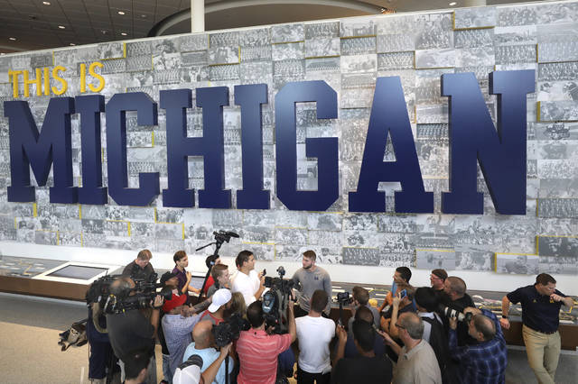 Michigan quarterback Shea Patterson speaks to reporters at Schembechler Hall in Ann Arbor, Mich., Thursday, Aug. 23, 2018. (Kurt Steiss/The Blade via AP)