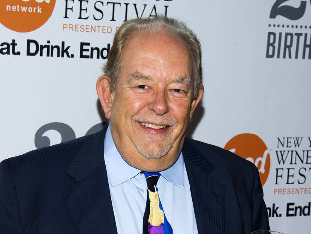 """FILE - In this Oct. 17, 2013 file photo, Robin Leach attends the Food Network's 20th birthday party in New York.  Leach, whose voice crystalized the opulent 1980s on TV's """"Lifestyles of the Rich and Famous,"""" has died, Friday, Aug. 24, 2018. (Photo by Charles Sykes/Invision/AP, File)"""