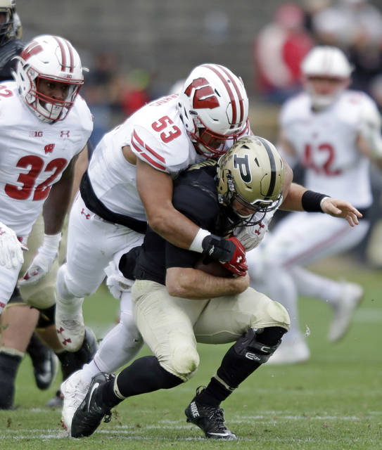 FILE- This Nov. 19, 2016, file photo shows Wisconsin linebacker T.J. Edwards (53) sacking Purdue quarterback David Blough (11) during the second half of an NCAA college football game in West Lafayette, Ind. The fourth-ranked Wisconsin Badgers' defense is a work in progress as the season begins with a mix of stars up the middle and untested replacements on the edges. Preseason All-American linebacker T.J. Edwards says that he is excited by the possibilities, (AP Photo/Michael Conroy, File)