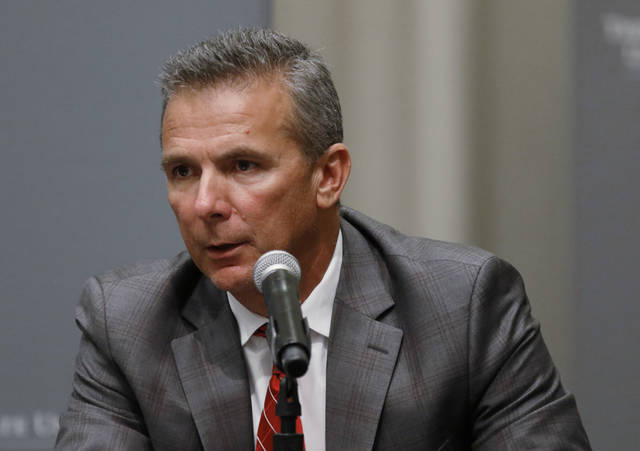 FILE - In this Aug. 22, 2018, file photo, Ohio State football coach Urban Meyer makes a statement during a news conference in Columbus, Ohio. Meyer's current suspension and previous paid leave have restricted him from talking football with his staff and athletes during August with one exception _ a team meeting the day after the suspension was announced. Emails from the senior vice president for human resources show Meyer and athletic director Gene Smith were allowed to meet with the players and coaches last Thursday, Aug. 23, 2018. (AP Photo/Paul Vernon, File)