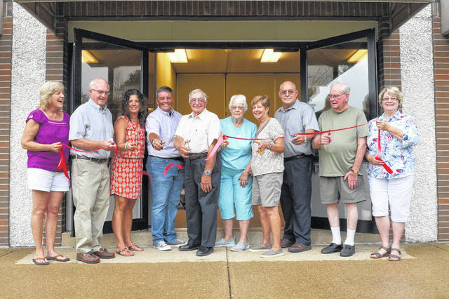 Big Walnut Friends Who Share volunteers and friends gathered at the new Friends Who Share Center's location at Sunbury United Methodist Church last Monday evening to hold a ribbon cutting ceremony. From left are Assistant Director of BWFWS Center (Board Member) Beth Jewell, Sunbury United Methodist Church Trustee Chair Bill Stroud, Sunbury Big Walnut Chamber of Commerce Board President Cindy Erndt, Sunbury Mayor Tommy Hatfield, Mayor, BWFWS Board President Larry Tornes, BWFWS Board Vice President Marsha Garee, BWFWS Founder Barb Jeffers, SUMC Pastor Mike Mack, BWFWS Center Director Gene Wampler, BWFWS Recording Secretary, Corresponding Secretary, and Board Secretary Cathy Cantrell.