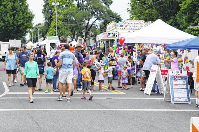 Galena's square became a midway during the village's annual Summerfest on Aug. 25. The event included live music, old Fords, fair fare, local vendors, pony rides and a slide for the kids.