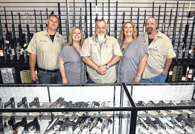 Left-to-right: Employees Jeff Fisher, Heidi Fisher, Adam Arrington, Nickie May and Kevin May stand inside The Gun Room, at 739 West Cherry Street (next door to Subway) on Aug. 10 during a ribbon cutting ceremony. The Gun Room, which opened Aug. 11, carries firearms, ammunition, scopes, shooting apparel, hats, and other shooting accessories. It also features gunsmith services by Jim Caudill, firearm cleaning, and Conceal Carry (CCW) classes. The first CCW class will be held on Saturday, September 15. Hours are Tuesday through Friday from 10 a.m. to 8 p.m.; Saturday from 10 a.m. to 6 p.m.; and Sunday from 10 a.m. to 5 p.m. The Gun Room is closed on Mondays. For more information, visit www.TheGunRoomofSunbury.com call 740-913-0278 or email info@TheGunRoomofSunbury.com.