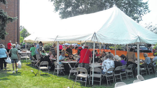 Locals dine at last year's Lions Club Ox Roast.