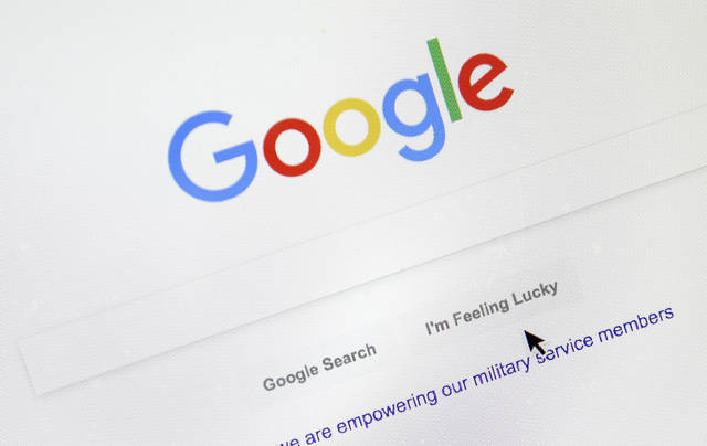 A cursor moves over Google's search engine page on Tuesday, Aug. 28, 2018, in Portland, Ore. Political leanings don't factor into Google's search algorithm. But the authoritativeness of page links the algorithm spits out and the perception of thousands of human raters do. (AP Photo/Don Ryan)
