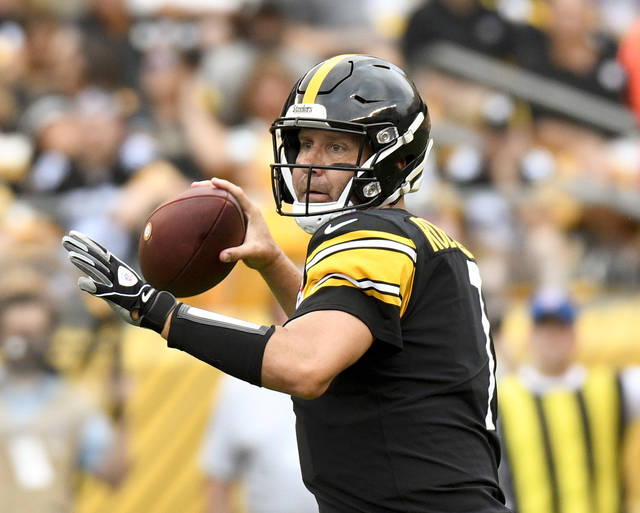 FILE - In this Aug. 25, 2018, file photo, Pittsburgh Steelers quarterback Ben Roethlisberger (7) passes in the first quarter of an NFL football game against the Tennessee Titans, in Pittsburgh. As long as Mike Tomlin is standing on the Pittsburgh sideline, watching Roethlisberger pass to Antonio Brown or stick the ball in the stomach of Le'Veon Bell, the Steelers will be favored to win the AFC North. (AP Photo/Don Wright, File)