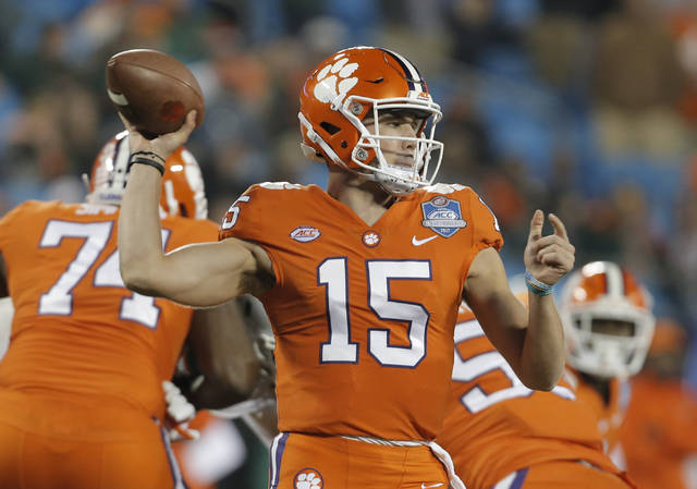 FILE - In this Saturday, Dec. 2, 2017 file photo, Clemson's Hunter Johnson (15) looks to pass against Miami during the second half of the Atlantic Coast Conference championship NCAA college football game in Charlotte, N.C. (AP Photo/Bob Leverone, File)
