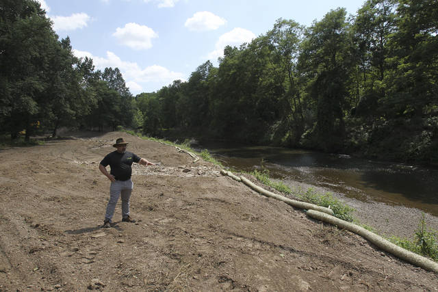 In this Thursday, Aug. 9, 2018 photo, Mike Johnson, Summit Metro Parks Chief of Conservation stands where a stream will become a tributary of the Cuyahoga River during a tour of the former Valley View Golf Course in Akron, Ohio. The Metro Parks are in the process of returning the land to its natural state and transforming it into a public park. (Karen Schiely/Akron Beacon Journal via AP)