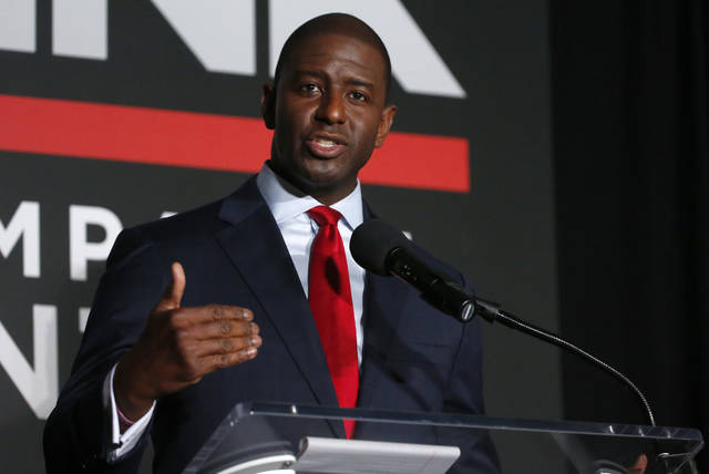 "File-This July 18, 2018, file photo shows Tallahassee Mayor Andrew Gillum speaking during a Democratic gubernatorial debate held at Florida Gulf Coast University's Cohen Center in Fort Myers, Fla. The man who could become Florida's first black governor on Sunday, Sept. 2, 2018, called on his opponent to refrain from name-calling and to focus on the issues. Gillum, was asked about comments Republican U.S. Rep. Ron DeSantis made after Tuesday's primary. DeSantis said voters aren't going to ""monkey this up"" by electing Gillum. (AP Photo/Wilfredo Lee, File)"