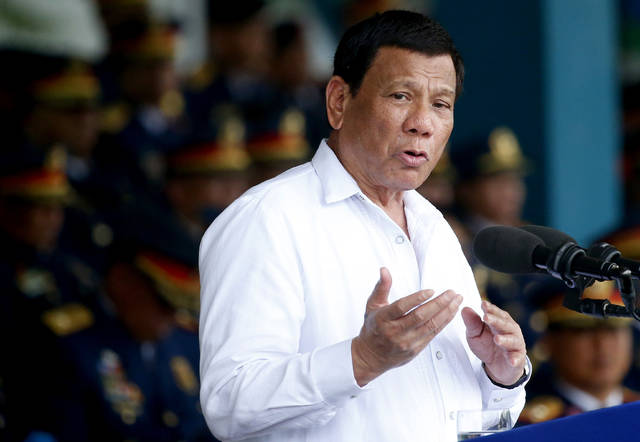 FILE - In this Aug. 8, 2018, file photo, Philippines president Rodrigo Duterte gestures while addressing police force to mark the 117th Philippine National Police Service anniversary at Camp Crame in Quezon city northeast of Manila. The first-ever visit to Israel of a leader of the Philippines is sure to be touted by Prime Minister Benjamin Netanyahu as another stirring success in his campaign to reverse years of isolation and enhance Israel's relations with various countries across the globe. (AP Photo/Bullit Marquez, File)