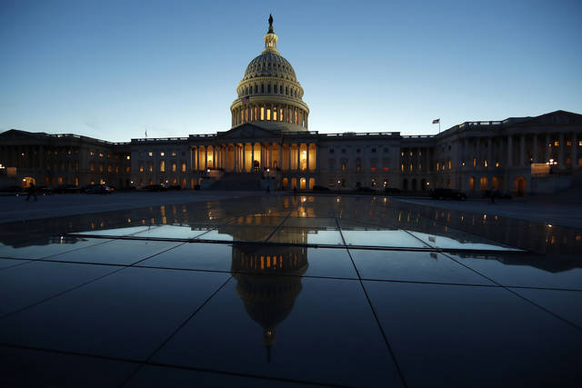 FILE - This March 5, 2018, file photo show the East Front of the U.S. Capitol at sunset in Washington. Just two months before the midterm elections, bipartisan legislation to try to prevent foreign hacking into U.S. election systems is stalled in Congress as the White House and some Republicans worry it could exert too much federal control over the states. Supporters of the bill say the delay could embolden Russia, which targeted election infrastructure in at least 21 states in 2016. (AP Photo/Alex Brandon, File)