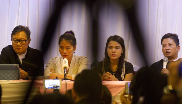 Than Zaw Aung, right, a lawyer of two Reuters journalists, talks to journalists during a press briefing together with Pan Ei Mon, second left, wife of Reuters journalist Wa Lone, Chit Su Win, second right, wife of Reuters journalist Kyaw Soe Oo, and Khin Maung Zaw, left, a lawyer of two Reuters journalists, at a hotel Tuesday, Sept. 4, 2018, in Yangon, Myanmar. A Myanmar court sentenced two Reuters journalists to seven years in prison Monday on charges of illegal possession of official documents, a ruling met with international condemnation that will add to outrage over the military's human rights abuses against Rohingya Muslims. (AP Photo/Thein Zaw)