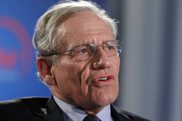 FILE - This June 11, 2012 file photo shows former Washington Post reporter Bob Woodward speaking during an event to commemorate the 40th anniversary of Watergate in Washington.  Details are starting to come out from journalist Bob Woodward's forthcoming book on President Donald Trump's first 18 months in office.  (AP Photo/Alex Brandon, file)