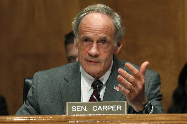 FILE - In this May 15, 2018, file photo, Sen. Thomas Carper, D-Del., asks a question of Homeland Security Secretary Kirstjen Nielsen as she testifies to the Senate Homeland Security Committee on Capitol Hill in Washington. Kerri Evelyn Harris, whose resume includes loading giant Air Force cargo planes, frying chicken at a convenience store chain and working as an auto body mechanic, is seeking in the Thursday, Sept. 6, Democratic primary to unseat three-term incumbent Carper, one of the most successful politicians in Delaware history. (AP Photo/Jacquelyn Martin, File)
