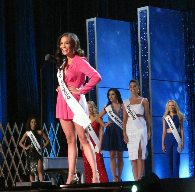 "Miss West Virginia Madeline Collins introduces herself during the third and final night of preliminary competition in the Miss America pageant in Atlantic City N.J. on Friday Sept. 7, 2018. Later in the night, during her onstage interview, Collins said President Trump ""has created a lot of division in this country."" (AP Photo/Wayne Parry)"