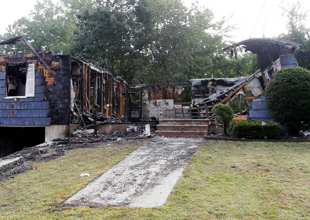 A damaged house on Jefferson Street, in Lawrence, Mass., is seen Friday, Sept. 14, 2018. The home was one of multiple houses that went up in flames on Thursday afternoon after gas explosions and fires triggered by a problem with a gas line that feeds homes in several communities north of Boston (AP Photo/Mary Schwalm)