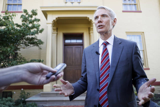 "Sen. Rob Portman, R-Ohio, is interviewed outside the William Howard Taft National Historic Site, Friday, Sept. 14, 2018, in Cincinnati. Portman, who's been a strong advocate for Supreme nominee Brett Kavanaugh, remains confident he will be confirmed after a ""way too partisan"" battle in Washington. (AP Photo/John Minchillo)"