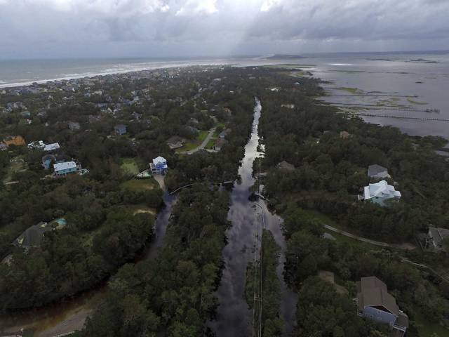 Coast Guard Road leading to the south end of Emerald Isle is seen after Hurricane Florence hit Emerald Isle, N.C., Sunday, Sept. 16, 2018. (AP Photo/Tom Copeland)