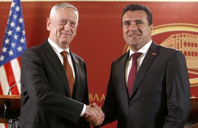 U.S. Defense Secretary James Mattis, left, shakes hands with Macedonian Prime Minister Zoran Zaev, right, during their meeting at the government building in Skopje, Macedonia, Monday, Sept. 17, 2018. Mattis arrived in Macedonia Monday, condemning Russian efforts to use its money and influence to build opposition to an upcoming vote that could pave the way for the country to join NATO, a move Moscow opposes. (AP Photo/Boris Grdanoski)